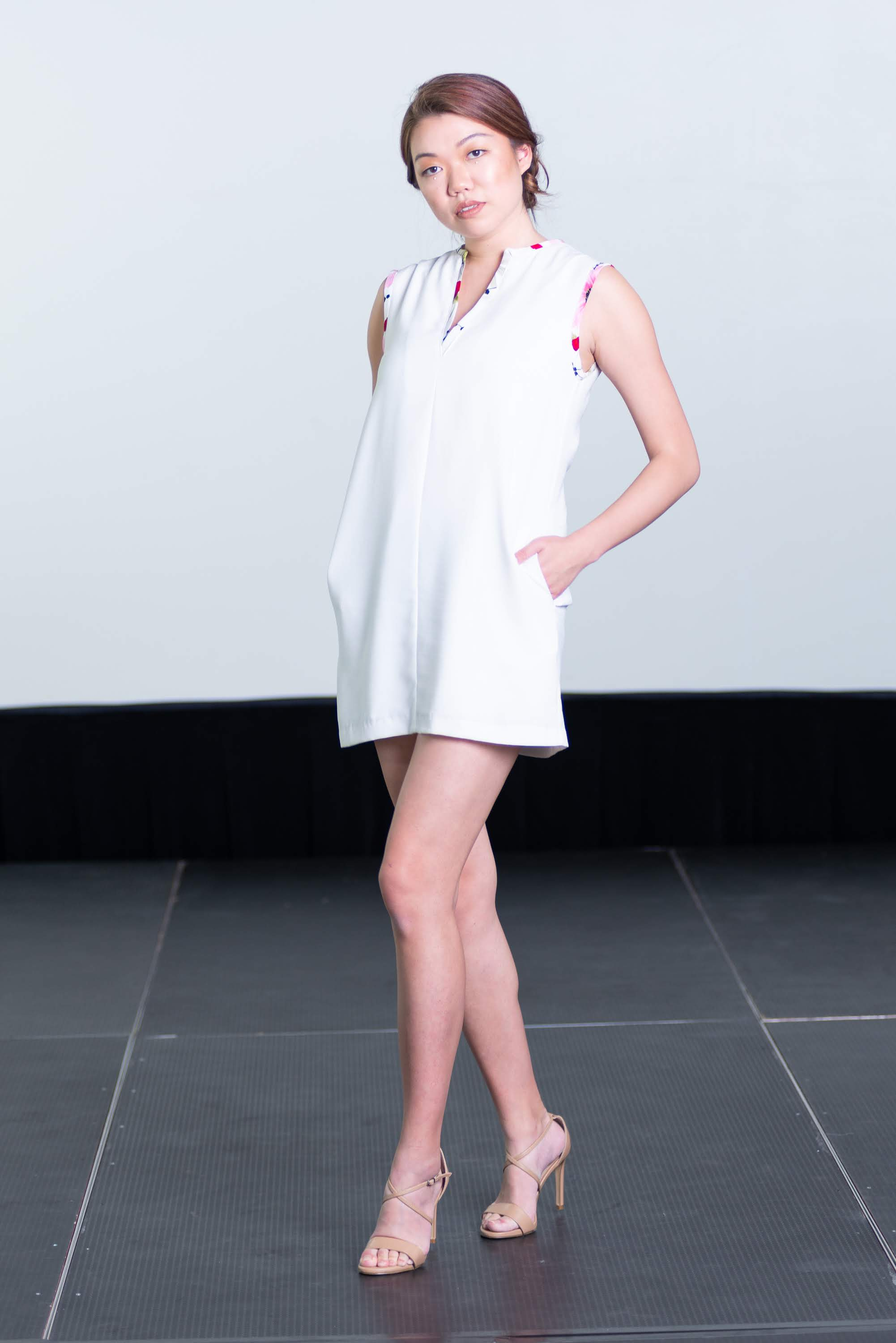 White Mini Shift Dress Accented with Floral Piping with Pockets and Peekaboo Cut-Out in Back
